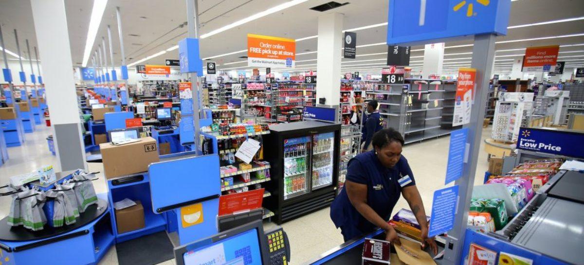 Walmart holiday quarter profit falls, comparable sales beat estimates